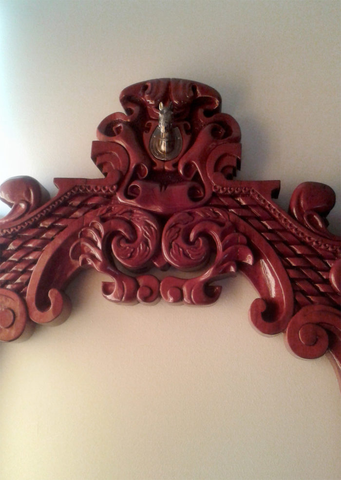 Fragment of custom made and carved frame