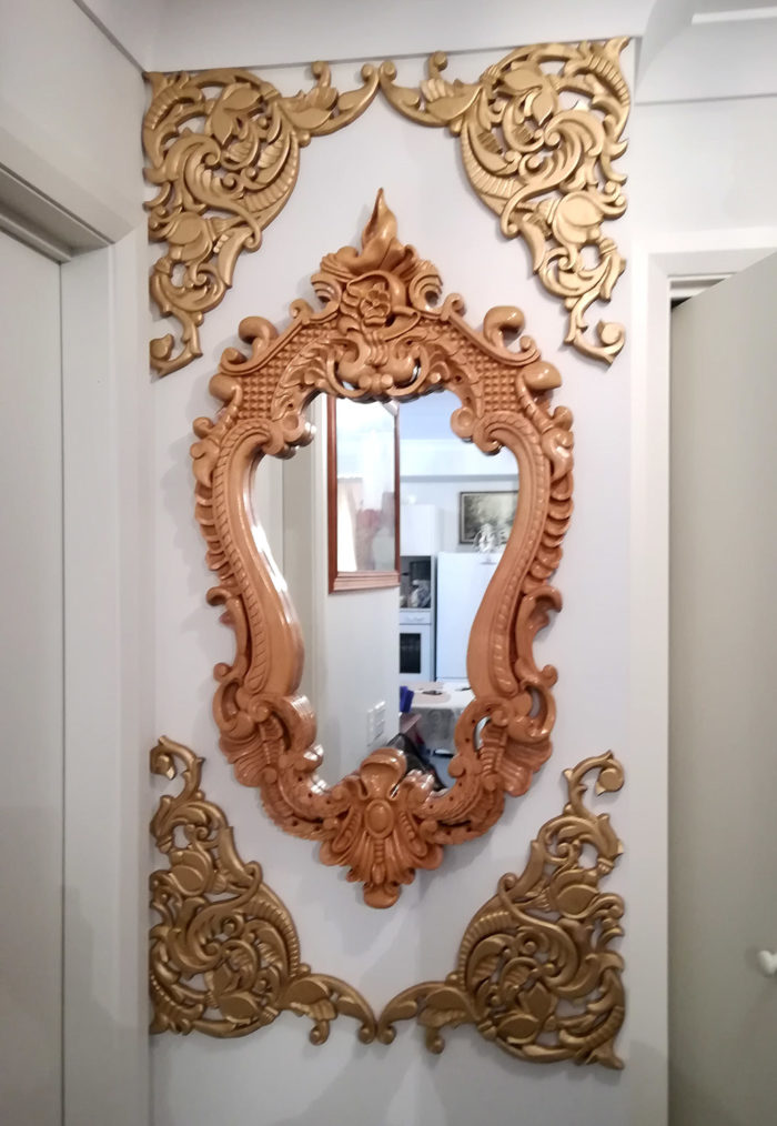 Custom made and carved mirror frame