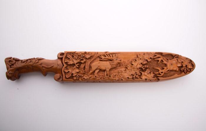Custom made and carved knife handle and sheath