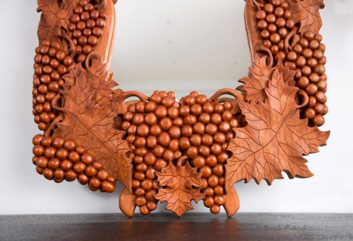 Fragment of custom mirror frame with grapes