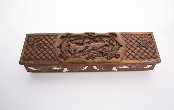Custom made and carved wooden box for knife