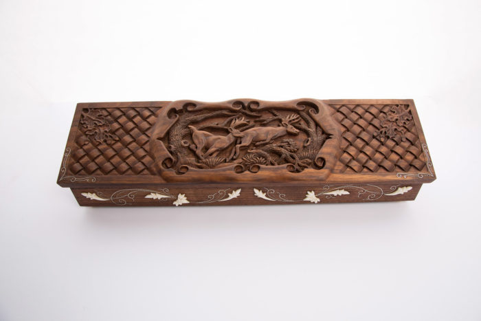 Custom made and carved wooden box for knife or gun